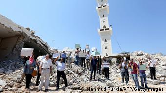 Libyan protesters gather on the rubble of a destroyed section of the mausoleum of Al-Shaab Al-Dahman near the centre of Tripoli on August 26, 2012 to condemn attempts to demolish it and to protest against Islamic extremism. Islamist hardliners bulldozed part of the revered mausoleum in Tripoli in the second such attack in Libya in two days. AFP PHOTO/MAHMUD TURKIA (Photo credit should read MAHMUD TURKIA/AFP/GettyImages)