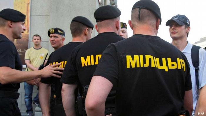 Belarusian policemen block a central street to protect it from an youth opposition action Revolution via social network in Minsk, Belarus, Wednesday, June 15, 2011.(AP)