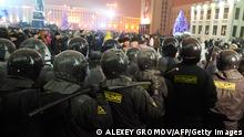 Riot police face protesters during an opposition rally in Minsk early on December 20, 2010. Belarus police arrested hundreds of protestors as they used force to break up a mass demonstration against the expected re-election of President Alexander Lukashenko in disputed polls on Sunday. AFP PHOTO/ ALEXEY GROMOV (Photo credit should read ALEXEY GROMOV/AFP/Getty Images)