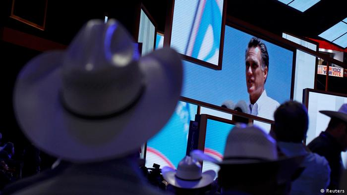 Romney on a screen at the convention Picture: Shannon Stapleton