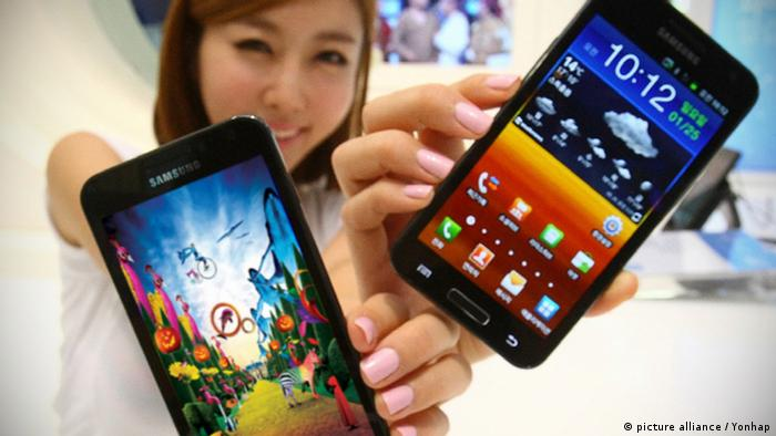 A woman holding two Samsung smart phones Photo courtesy of Samsung (Yonhap)/