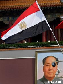 Egypt's national flag flies in front of the giant portrait of former Chinese Chairman Mao Zedong at Tiananmen Square in Beijing, August 28, 2012. Egyptian President Mohamed Mursi is on a three-day visit to China from August 28 to 30. REUTERS/Petar Kujundzic (CHINA - Tags: POLITICS)