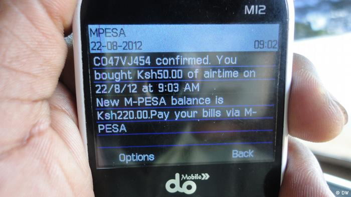 An image of a mobile phone screen with M-pesa. Photo: Alfred Kiti / DW)