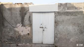 Rimsha Masih's small house, with a locked front door, in a village close to Islamabad