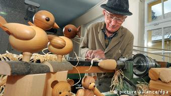 Klaus Weber works on his wooden toys