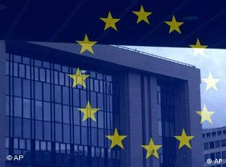 The European Council building is reflected in a photograph of the EU flag on the wall of the European Council building in Brussels