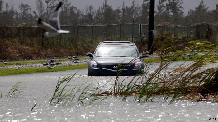 A car sits stranded in rising floodwaters from Isaac, in southern Louisiana