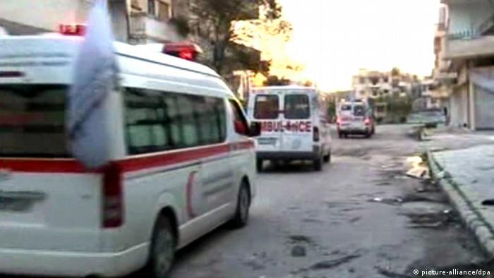 Syrian Arab Red Crescent ambulances rushing through Homs