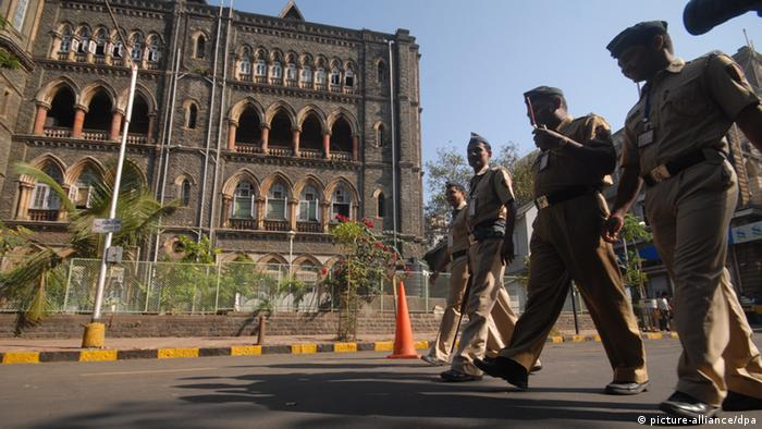 Indian policemen stand guard outside the high court, where Mohammed Ajmal Amir Kasab's appeal is being held, in Mumbai, India, 21 February 2011.