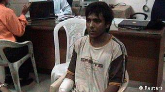 Mohammed Ajmal Kasab is seen at an undisclosed location in this file still image from undated footage shown on CNN IBN Television channel on February 3, 2009.