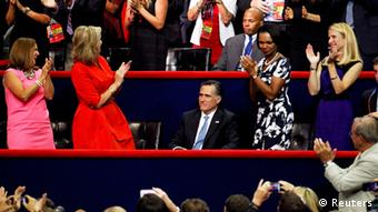 Republican presidential nominee Mitt Romney is applauded by his wife Ann (2nd L), former U.S. Secretary of State Condoleezza Rice (2nd R) and the rest of the crowd at the end of the second session of the 2012 Republican National Convention in Tampa, Florida August 28, 2012. REUTERS/Joe Skipper (UNITED STATES - Tags: POLITICS ELECTIONS)
