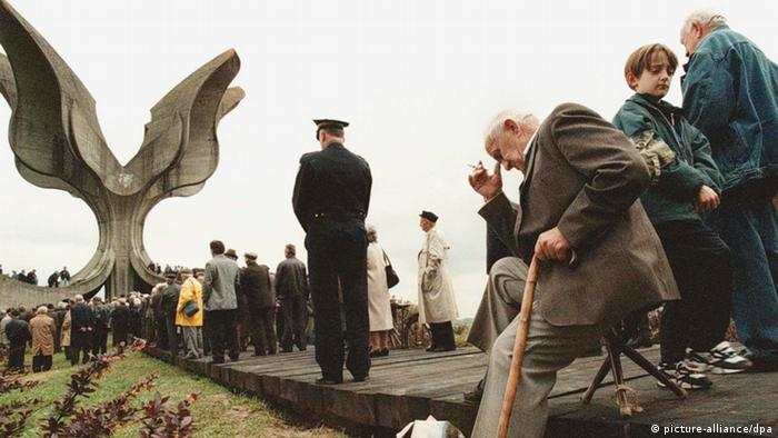 An unindentified former inmate (L) of the Jasenovac concentration camp sits on a chair contemplating amongst several thousands of people, during a commemorative ceremony marking the 54th anniversary of the liberation of the Jasenovac concentration camp by Yugoslav partisans near the village of Jasenovac, Sunday 25 April 1999. Tens of thousands Jews, gipsies, Serbs, Croats, and others have lost their lives in the camp, run by the Croatian Nazi Usthashi authorities from 1941 until 1945. dpa