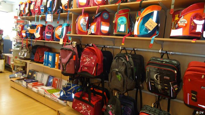 Backpacks, binders and noteworks line the shelves of a supply store