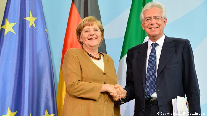 German Chancellor Angela Merkel and Italian Prime Minister Mario Monti shake hands after addressing a joint press conference at the Chancellery in Berlin on August 29, 2012. Monti's visit to the German capital is the latest shuttle diplomacy that already brought the French president and Greek premier to the German chancellor's office in quick succession last week. AFP PHOTO / ODD ANDERSEN (Photo credit should read ODD ANDERSEN/AFP/GettyImages)