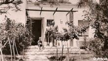 The Bensinger family before their house in Holon, Tel Aviv in 1950