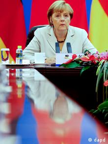 German Chancellor Angela Merkel holds a bilateral talks with Chinese Premier Wen Jiabao, unseen, inside the Great Hall of the People in Beijing Thursday, Aug. 30, 2012. Merkel is on a two-day official visit to China. (Foto:Diego Azubel, Pool/AP/dapd)