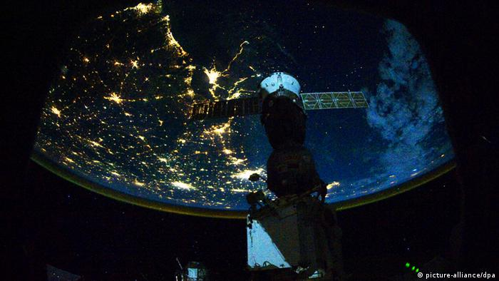 From 220 miles above Earth, the Expedition 25 crew aboard the International Space Station shot this night time image of the northern Gulf coast in November 2010. Mobile Bay and the city of Mobile (top left, beneath one of the solar panels of a docked Russian Soyuz spacecraft), New Orleans and Houston are visible as the view moves southeastward. The Interstate Highway 20 cities of Jackson, Shreveport, Dallas and Fort Worth are also visible further inland. The view extends northward (left) to Little Rock and Oklahoma City. Photo NASA