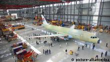 An Airbus A320, ordered by China Eastern, is seen on the assembly line at a plant of Airbus (Tianjin) Final Assembly Company Ltd. in Tianjin, China, Tuesday, 23 June 2009. Airbus SAS, the worlds largest commercial planemaker, rolled out the first aircraft assembled on Tuesday (June 23, 2009) at its China factory as it seeks to win more orders in the worlds second-largest aviation market. The planemaker aims to deliver 10 more A320s this year from its factory in Tianjin, it said in a statement. Production at the plant, Airbuss first outside Europe, will be raised to four aircraft a month by the end of 2011. Photo: Imaginechina/Bao fan +++(c) dpa - Report+++