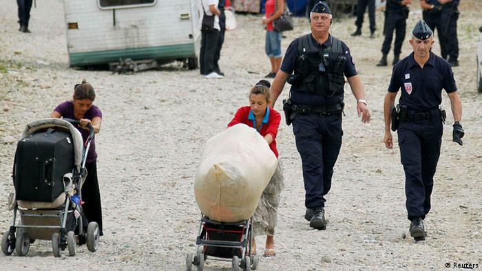 French police evacuate families and remove their caravans from an illegal camp in Saint-Priest, near Lyon