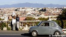GettyImages 84670521 (FILES) This file picture taken on November 20, 2004 in Rome shows an old Fiat 500 driven on the Gianicolo hill, traditional Rome's panoramic street. Italian Prime Minister Silvio Berlusconi said on February 6, 2009 that the government had adopted new measures worth 2.0 billion euros (2.6 billion dollars) to help the economy, in particular the car industry and to encourage Italians to buy new and less polluting cars. AFP PHOTO/FILES/ ANDREAS SOLARO (Photo credit should read ANDREAS SOLARO/AFP/Getty Images)