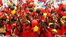 Supporters of the ruling MPLA party cheers during the party's last rally for the parliamentary elections in Camama, outside the capital Luanda, August 29, 2012. Angolans will go to the polls on Friday to elect lawmakers and their president. Picture taken August 29, 2012. REUTERS/Siphiwe Sibeko (ANGOLA - Tags: POLITICS ELECTIONS)