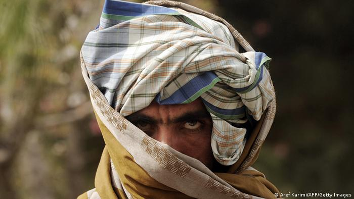 A former Taliban fighter looks on after joining Afghan government forces during a ceremony in Herat province on March 26, 2012. (Photo: AFP)
