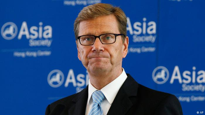 German Foreign Minister Guido Westerwelle speaks at a luncheon in Hong Kong Friday, Aug. 31, 2012. Guido Westerwelle said Friday that his country feels solidarity with Greece as it undertakes painful austerity reforms in order for it to continue receiving international funding protecting the debt-stricken Mediterranean country from bankruptcy. Westerwelle's comments to business leaders in Hong Kong are a sign that Germany hasn't become any more flexible towards Greece, whose leaders have been seeking some wiggle room on the cuts. (Foto:Kin Cheung/AP/dapd)