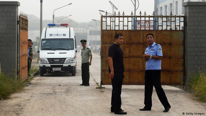 Chinese police wait outside the Number Two prison after the release of dissident Wang. Photo: MARK RALSTON/AFP/GettyImages)