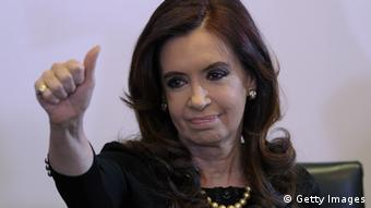 Argentine President Cristina Kirchner gives the thumbs up during the presentation of the new 100 pesos bill with the portrait of Eva Duarte de Peron, popularly known as Evita, second wife of three times Argentine President Juan Peron, during a ceremony held at Casa Rosada government house in Buenos Aires on July 25, 2012. Argentina on Thursday will commemorate the 60th anniversary of the death of Evita, who was called the standard-bearer of the humble. AFP PHOTO/Juan Mabromata (Photo credit should read JUAN MABROMATA/AFP/GettyImages)