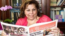 Karen Gerson with an issue of El Amaneser in 2012