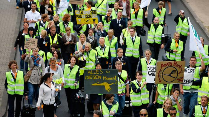 Hundreds of members of German air carrier Lufthansa cabin crew union UFO walk towards the Lufthansa headquarters during a strike at the Fraport airport in Frankfurt, August 31, 2012. Lufthansa cancelled 64 flights at its main hub Frankfurt on Friday as cabin crew began the first of a series of strikes over pay and cost cuts in a busy holiday season. The eight-hour industrial action, following the breakdown of 13 months of negotiations between Germany's largest airline and trade union UFO, is due to end at 1100 GMT on Friday. REUTERS/Kai Pfaffenbach (GERMANY - Tags: BUSINESS EMPLOYMENT CIVIL UNREST TRANSPORT)