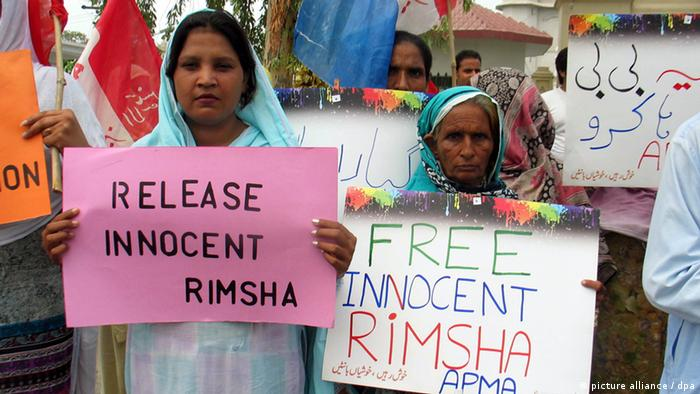 Pakistani Christian minority members carry placards for the release of a Christian girl, Rimsha, with Down's syndrome, who was arrested on charges of blasphemy on the outskirts of Islamabad, during a protest in Faisalabad, Pakistan.