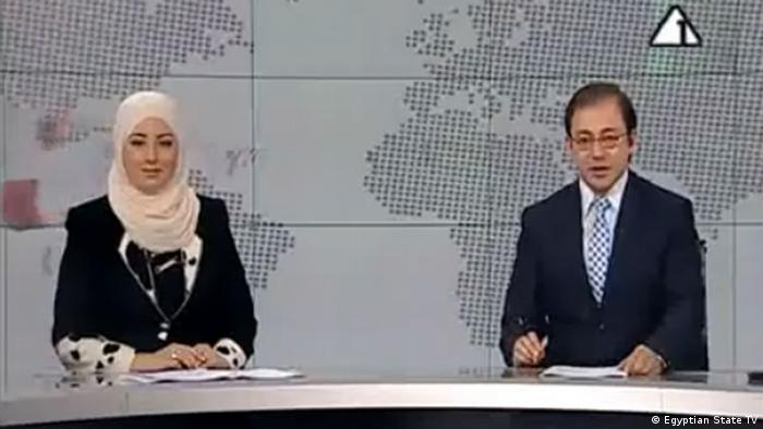 Fatma Nabil in a headscarf and her co-anchor