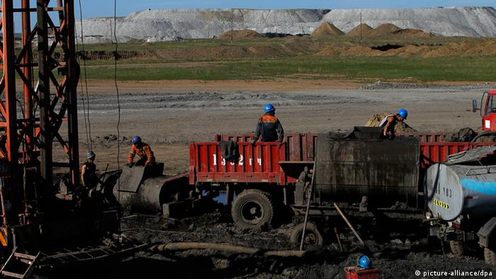 Mongolian miners working in Baganuur coal mine in Banganuur city, Mongolia EPA/HOW HWEE YOUNG