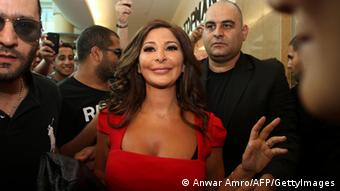 Lebanese pop star Elissa, surrounded by her bodyguards, attends a ceremony after releasing her recent album 'Asaad Wahda' at Beirut's Virgin City mall on July 13, 2012 (Photo: Anwar Amro/AFP/GettyImages)