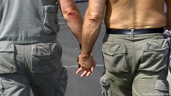 Two men walk hand in hand (Photo: Tim Brakemeier dpa/lrs)