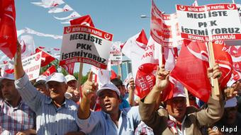 Thousands of Turks demonstrate to condemn terrorism in Ankara, Turkey, in September 2012. The banner reads: We don't want the PKK (Kurdistan Workers Party) at the parliament. (Photo: AP/dapd)