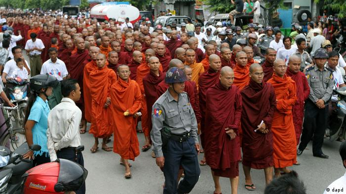 Myanmar Buddhist monks stage a rally to protest against ethnic minority Rohingya Muslims and to support Myanmar President Thein Sein's stance toward the sectarian violence that took place in June between ethnic Rakhine Buddhists and Rohingya Muslims in western Myanmar, in Mandalay, central Myanmar, on Sunday, Sept. 2, 2012. (AP Photo/Khin Maung Win)