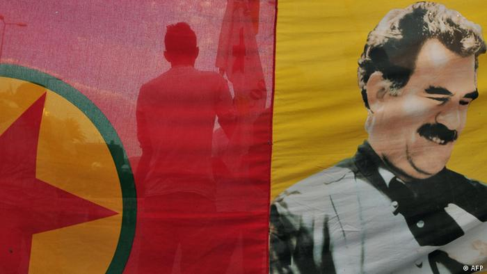 Kurds living in Greece hold a banner featuring the portrait of former PKK leader Ocalan LOUISA GOULIAMAKI/AFP/Getty Images)