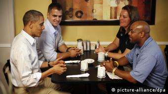 Obama sitting down with three autoworkers (AP Photo/Pablo Martinez Monsivais)