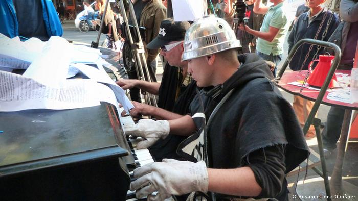 Men play a piano at the eviction of Tacheles in Berlin on 04.09.2012
