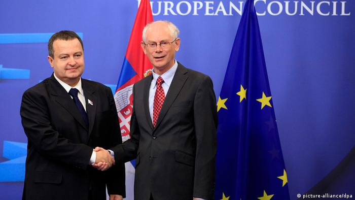 epa03382458 The Prime Minister of Serbia, Ivica Dacic (L), is welcomed by the President of the European Council, Herman Van Rompuy (R) prior to a meeting at the EU headquarters in Brussels, Belgium, 04 September 2012. EPA/OLIVIER HOSLET