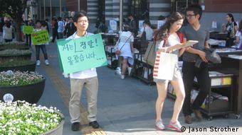 Ji Seong-ho, a disabled North Korean refugee, protests against human rights violations in his former homeland