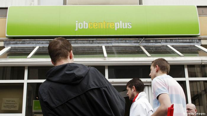 Young people standing outside the Job Centre in England. Photo: ADRIAN DENNIS/AFP/Getty Images