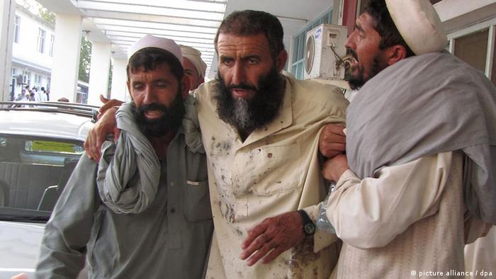 A man who was injured in a suicide bomb attack at a funeral in Dur Baba district, is rushed to a hospital in Ghanikhel district, of Nangarhar province, Afghanistan, 04 September 2012.