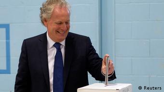 Charest casting his vote on Tuesday