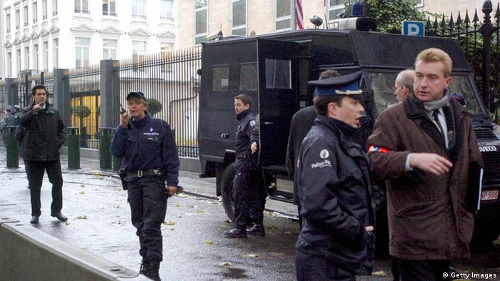 Belgian police outside of the US embassy in Brussels (Photo credit should read HERWIG VERGULT/AFP/Getty Images)