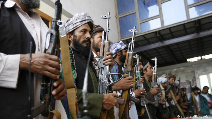 A group of 21 former Taliban militants after surrendering their weapons during a reconciliation ceremony in Herat, Afghanistan, 14 July 2012 (Photo: EPA/JALIL REZAYEE +++(c) dpa - Bildfunk+++)