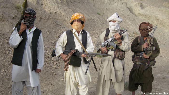 Taliban militants in the mountains of Helmand, Afghanistan (Photo: EPA / STRINGER +++(c) dpa - Report+++)