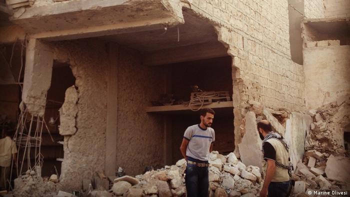 Destroyed building in Ma'at Masrin Foto: Marine Olivesi, August 2012
